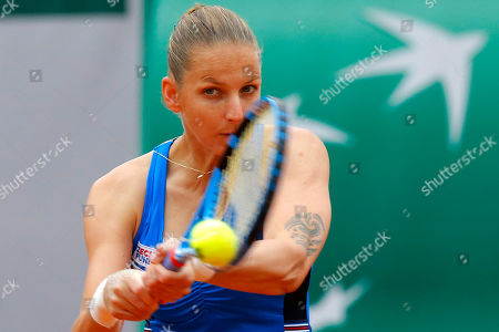 Stock Image of Krystina Pliskova of the Czech Republic plays a shot against Madison Brengle of the U.S. during their first round match of the French Open tennis tournament at the Roland Garros stadium in Paris