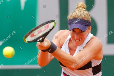 Stock Photo of Madison Brengle of the U.S. plays a shot against Krystina Pliskova of the Czech Republic during their first round match of the French Open tennis tournament at the Roland Garros stadium in Paris