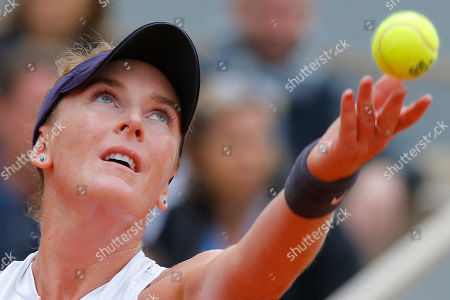 Madison Brengle of the U.S. serves against Krystina Pliskova of the Czech Republic during their first round match of the French Open tennis tournament at the Roland Garros stadium in Paris