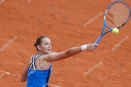Krystina Pliskova of the Czech Republic plays a shot against Madison Brengle of the U.S. during their first round match of the French Open tennis tournament at the Roland Garros stadium in Paris