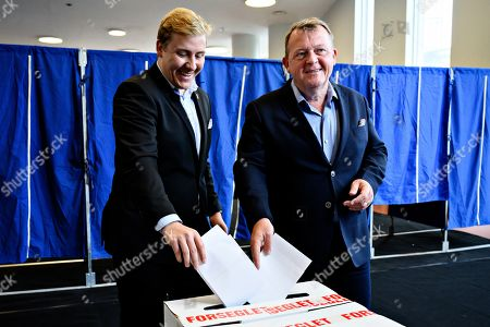 Prime Minister Lars Loekke Rasmussen and his son Bergur Loekke Rasmussen from the Liberal Party vote at Nyboder School during the European Parliament elections 2019 in Copenhagen, Denmark, 26 May 2019. The polls during the European Parliament elections in Denmark will open at 09.00 and close at 20.00.