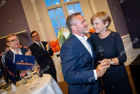 Stock Photo of Anders Samuelsen (2-R), Danish Minister of Foreign Affairs and head of Liberal Alliance with his sister, Mette Bock (R), leading candidate from Liberal Alliance for the European Parliament elections 2019 during the election party at Christiansborg in Copenhagen, Denmark, 26 May 2019. The European Parliament election is held by member countries of the European Union (EU) from 23 to 26 May 2019.