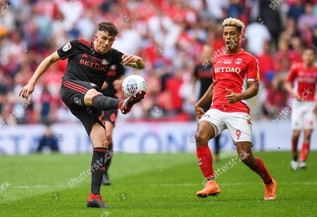 Tom Flanagan of Sunderland clears as Lyle Taylor of Charlton Athletic looks on