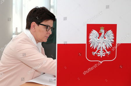 Deputy Polish Prime Minister Beata Szydlo casts her vote at a polling station during the European elections in Brzeszcze, southern Poland, 26 May 2019. The European Parliament election is being held by member countries of the European Union from 23 to 26 May 2019.