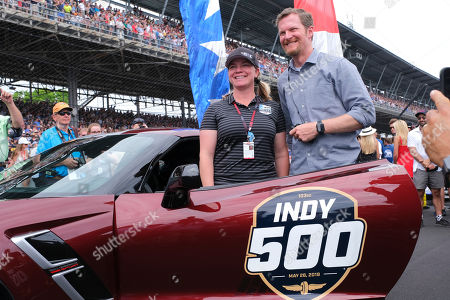 Stock Photo of Dale Earnhardt Jr. poses with Sarah Fisher before driving the pace car to start the Indianapolis 500 IndyCar auto race at Indianapolis Motor Speedway, in Indianapolis
