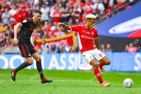 Lyle Taylor of Charlton Athletic (9) and Tom Flanagan of Sunderland (12) in action during the EFL Sky Bet League 1 play off final match between Charlton Athletic and Sunderland at Wembley Stadium, London