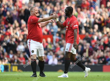 Stock Picture of Louis Saha of Manchester United celebrates with David May after scoring his side's fourth goal