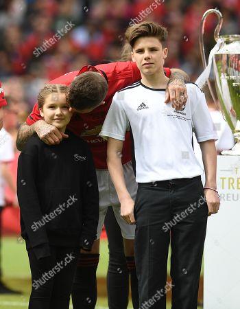 David Beckham of Manchester United with his children Harper and Cruz