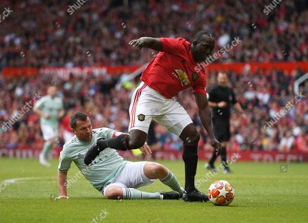Stock Photo of Dwight Yorke of Manchester United and Lothar Matthaus of Bayern Munich