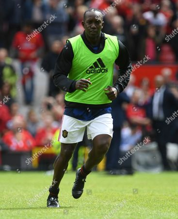 Stock Photo of Dwight Yorke of Manchester United warms up