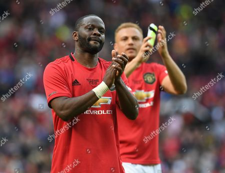 Stock Photo of Louis Saha of Manchester United applauds the fans at full time