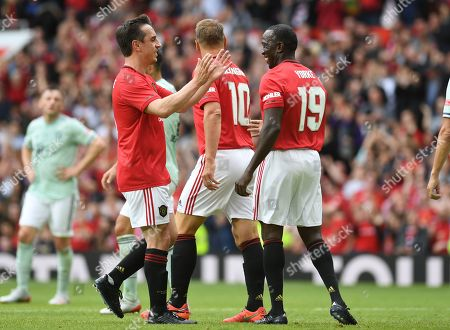 Dwight Yorke of Manchester United celebrates with Gary Neville after scoring his side's second goal