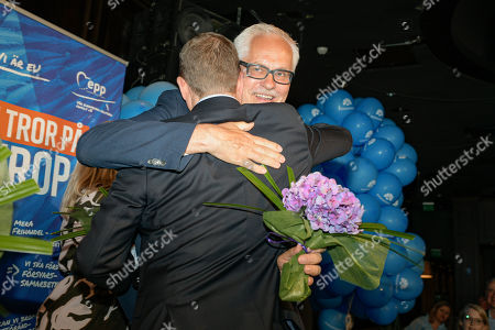 National Coalition Party leader Petteri Orpo (L) hugs party member Petri Sarvamaa (R) during the European elections in Helsinki, Finland, 26 May 2019. The European Parliament election was held by member countries of the European Union (EU) from 23 to 26 May 2019.