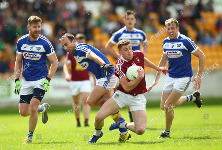 Westmeath vs Laois. Westmeath's Ger Egan tackled by Denis Booth, Gareth Dillon and Kieran Lillis of Laois