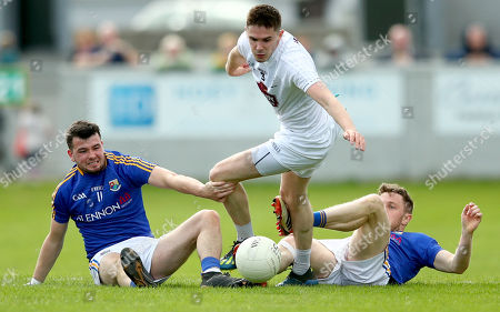 Kildare vs Longford. Longford's Barry McKeon and Daniel Mimnagh with David Hyland of Longford