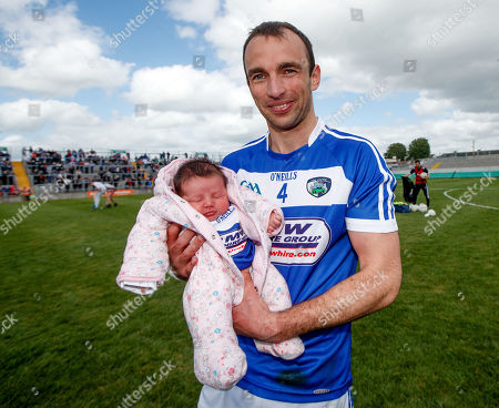 Stock Picture of Westmeath vs Laois. Laois' Gareth Dillon celebrates with his 2 week old daughter Ella