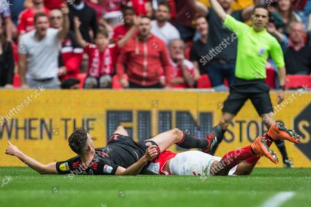 Lyle Taylor (Charlton) & Tom Flanagan (Sunderland) collide during the EFL Sky Bet League 1 play off final match between Charlton Athletic and Sunderland at Wembley Stadium, London