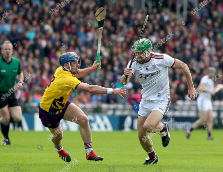Galway vs Wexford. Wexford's Kevin Foley and David Burke of Galway