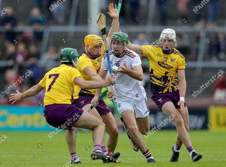 Stock Photo of Galway vs Wexford. Galway's Brian Concannon is tackled by Damien Reck and Rory O'Connor of Wexford