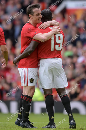 Gary Neville celebrates as Dwight Yorke scores the second goal of the game