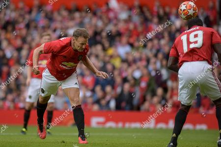 Teddy Sheringham heads towards goal