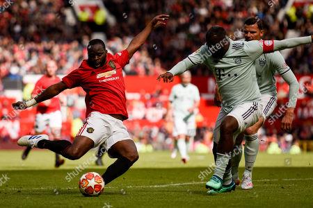 Louis Saha shoots during the second half
