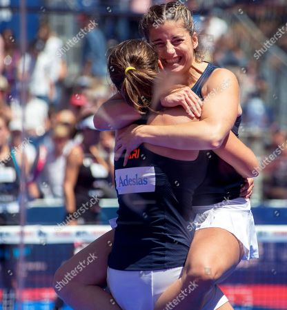 Spanish players Alejandra Salazar (R) and Ariana Sanchez (L) celebrate after defeating their compatriots Marta Marrero and Marta Ortega in their women's final of the Aliseda Ledus Jaen Padel Open as part of the World Padel Tour in Jaen, southern Spain, 26 May 2019.