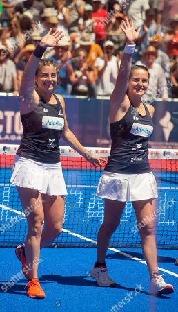Spanish players Alejandra Salazar (L) and Ariana Sanchez (R) celebrate after defeating their compatriots Marta Marrero and Marta Ortega in their women's final of the Aliseda Ledus Jaen Padel Open as part of the World Padel Tour in Jaen, southern Spain, 26 May 2019.