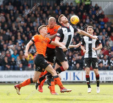 Gary MacKenzie of St. Mirren heads the ball above Paul Watson & Mark Connolly of Dundee United