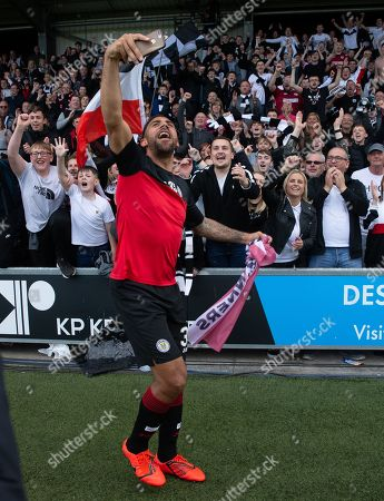 Anton Ferdinand of St. Mirren celebrates with fans after they beat Dundee United on penalty kicks to win the Ladbrokes Scottish Premiership Play-off Final to stay in the Premier League.