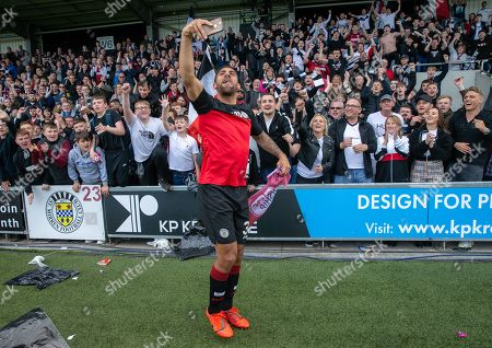 Stock Picture of Anton Ferdinand of St. Mirren celebrates with fans after they beat Dundee United on penalty kicks to win the Ladbrokes Scottish Premiership Play-off Final to stay in the Premier League.