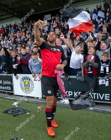 Stock Photo of Anton Ferdinand of St. Mirren celebrates with fans after they beat Dundee United on penalty kicks to win the Ladbrokes Scottish Premiership Play-off Final to stay in the Premier League.