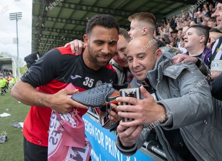 Stock Image of Anton Ferdinand of St. Mirren celebrates with fans after they beat Dundee United on penalty kicks to win the Ladbrokes Scottish Premiership Play-off Final to stay in the Premier League.