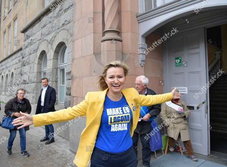 Stock Image of Ebba Busch Thor, Party leader of Sweden's Christian Democrats, distributes candidates lists for the European Parliament elections at a polling station in a school in Stockholm, Sweden, 26 May 2019. The European Parliament election is held by member countries of the European Union (EU) from 23 to 26 May 2019.