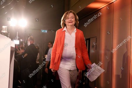 Nathalie Loiseau, center, head of French president Emmanuel Macron's party list, arrives to deliver her speech at the campaign headquarters, in Paris. Exit polls in France indicated that Marine Le Pen's far-right National Rally party came out on top, in an astounding rebuke for French President Emmanuel Macron, who has made EU integration the heart of his presidency