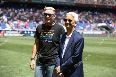 Former United States women's national team player Abby Wambach, left, and Sunil Gulati, the former President of the United States Soccer Federation, pose for a photo during a celebration honoring the National Soccer Hall of Fame Class of 2019 at halftime of an international friendly soccer match between the United States and Mexico, in Harrison, N.J. The U.S. won 3-0
