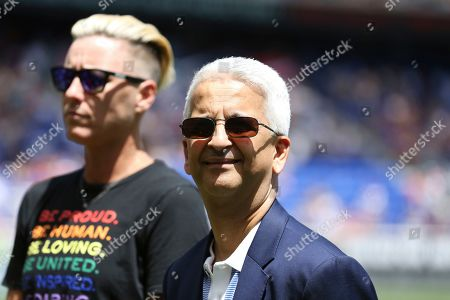 Stock Image of Sunil Gulati, the former President of the United States Soccer Federation, center, and former United States women's national team player Abby Wambach, pose for a photo during a celebration honoring the National Soccer Hall of Fame Class of 2019 at halftime of an international friendly soccer match between the United States and Mexico, in Harrison, N.J. The U.S. won 3-0
