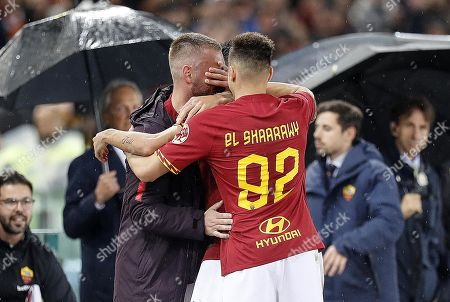 Roma's Diego Perotti (C, hidden) celebrates with his teammates Daniele De Rossi (L) and Stephan El Shaarawy (R) after scoring the 2-1 lead during the Italian Serie A soccer match between AS Roma and Parma Calcio at the Olimpico stadium in Rome, Italy, 26 May 2019.