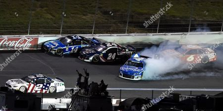 Kyle Larson (42) spins as Clint Bowyer (14), William Byron (24) and Ryan Newman (6) drive past during the NASCAR Cup Series auto race at Charlotte Motor Speedway in Concord, N.C