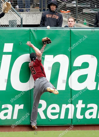 Arizona Diamondbacks left fielder Blake Swihart (19) cannot make the catch as he collides with the wall on a hit by San Francisco Giants' Stephen Vogt during the ninth inning of a baseball game in San Francisco