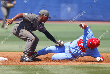 Vanderbilt second baseman Harrison Ray (2) tags Mississippi's Thomas Dillard (6) out as he slides into second base during the first inning of the Southeastern Conference tournament NCAA college baseball championship game, in Hoover, Ala