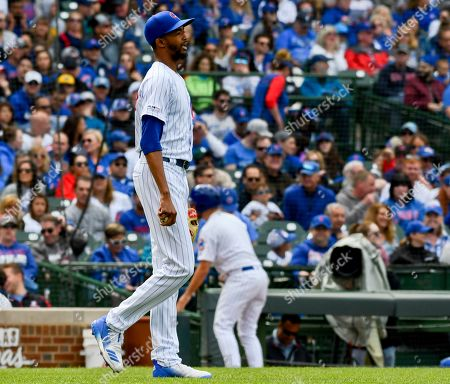 Chicago Cubs relief pitcher Carl Edwards Jr. (6) after throwing a wild pitch during the sixth inning of a baseball game against the Cincinnati Reds, in Chicago
