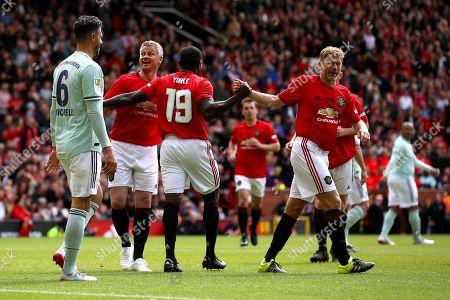 Stock Picture of Dwight Yorke, Ole Gunnar Solskjaer and Jesper Blomqvist celebrate Manchester United taking the lead