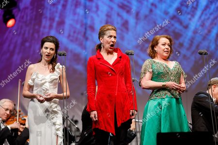 Nina Stemme (R), Stephanie Houtzeel (C) and Chen Reiss (L)perform onstage during a concert outside the opera house in Vienna, Austria, 26 May 2019. The Jubilee concert outside the opera is free for all and features ensemble singers, international guest artists, the orchestra and chorus of the Wiener Staatsoper under conductor Marco Armiliato.