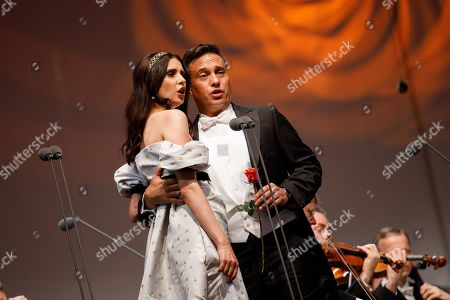 Uruguayan born Spanish bass-baritone Erwin Schrott (R) and Opera singer Valentina Nafornita (L) perform onstage during a concert outside the opera house in Vienna, Austria, 26 May 2019. The Jubilee concert outside the opera is free for all and features ensemble singers, international guest artists, the orchestra and chorus of the Wiener Staatsoper under conductor Marco Armiliato.
