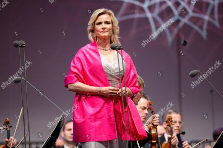 Opera singer Camilla Nylund performs onstage during a concert outside the opera house in Vienna, Austria, 26 May 2019. The Jubilee concert outside the opera is free for all and features ensemble singers, international guest artists, the orchestra and chorus of the Wiener Staatsoper under conductor Marco Armiliato.