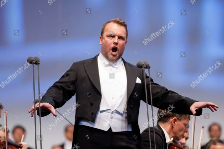 Opera singer Thomas Konieczny performs onstage during a concert outside the opera house in Vienna, Austria, 26 May 2019. The Jubilee concert outside the opera is free for all and features ensemble singers, international guest artists, the orchestra and chorus of the Wiener Staatsoper under conductor Marco Armiliato.