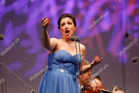 Ukrainian soprano Olga Bezsmertna performs onstage during a concert outside the opera house in Vienna, Austria, 26 May 2019. The Jubilee concert outside the opera is free for all and features ensemble singers, international guest artists, the orchestra and chorus of the Wiener Staatsoper under conductor Marco Armiliato.