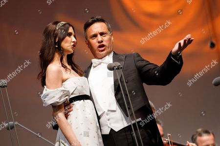Stock Picture of Uruguayan born Spanish bass-baritone Erwin Schrott (R) and Opera singer Valentina Nafornita (L) perform onstage during a concert outside the opera house in Vienna, Austria, 26 May 2019. The Jubilee concert outside the opera is free for all and features ensemble singers, international guest artists, the orchestra and chorus of the Wiener Staatsoper under conductor Marco Armiliato.