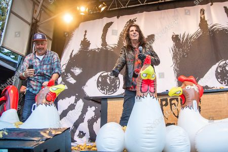 Andrew Zimmern, Alice Cooper. Andrew Zimmern, left, and Alice Cooper are seen at the BottleRock Napa Valley Music Festival at Napa Valley Expo as they attempt to break a world record, in Napa, Calif